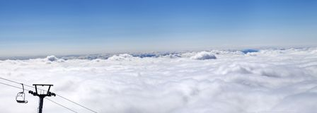 Panorama of mountains under clouds at nice sun day Stock Photography