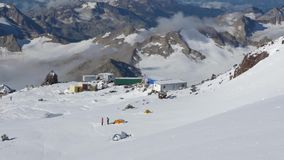 Panorama of the mountains. A view of the camp of climbers from the top point. Mount Elbrus, Caucasus, height 4300 m. HD stock footage