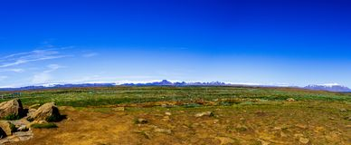 Panorama of mountains, volcanic fields and blue sky in Iceland stock image