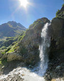 Panorama of mountains with waterfall Stock Images