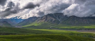 Panorama of Mt Mather and Herschel in Denali National Park. The clouds obstructed Denali but Mt Mather and herschel are visible in the foreground Royalty Free Stock Photo