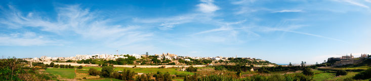 Panorama of Mtarfa Ridge. Malta - a small town close to Mdina (seen on the far right of the image) which had originally been as a Military Barracks in 1890 by Stock Photos