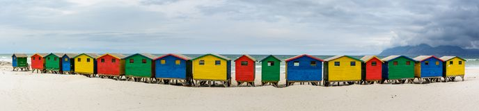 Panorama of Muizenberg, Cape Town, South Africa. Ultra wide panorama of the colourful beach houses on Muizenberg beach - a popular tourist attraction near Cape stock photo