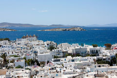 Panorama of Mykonos in Greece. View on the sea and the panorama of Mykonos with famous windmills in Greece Royalty Free Stock Photo