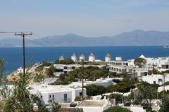 Panorama of Mykonos. Overhead view of Mykonos with windmills in the distance Royalty Free Stock Photo