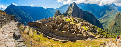 Panorama of Mysterious city - Machu Picchu, Peru, South America. The Incan ruins. Example of polygonal masonry and skill stock photo
