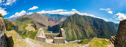 Panorama of Mysterious city - Machu Picchu, Peru,South America. The Incan ruins and terrace. Royalty Free Stock Images