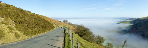 Panorama narrow road Welsh hills morning mist. Stock Image