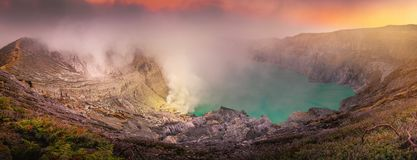 Panorama natural landscape of Kawah Ijen crater at sunrise scene., Panoramic scenery of volcano mount at Java, Indonesia., Travel. Destination and adventure royalty free stock photography