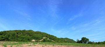 Panorama of the nature and environment with blue sky in the beautiful green hills. Mountain landscape Stock Photography