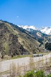 Panorama of nature  green mountains, snow and  sky in Chimbulak Almaty,  Kazakhstan Royalty Free Stock Images