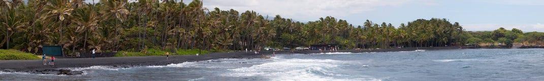 Panorama negro de la playa de las arenas Foto de archivo libre de regalías