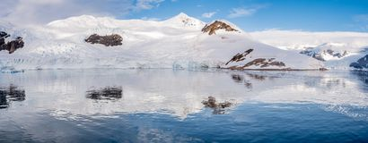 Panorama of Neko Harbor with glacier and red tents on camp site. Panorama of Neko Harbour bay with glacier and red tents on camp site, Arctowski Peninsula royalty free stock image