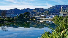 Panorama of Nelson City, reflected in the Maitai River, New Zealand royalty free stock image