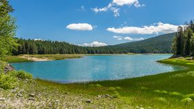 Panorama nero del lago Fotografie Stock