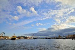 Panorama of Neva river with the ice breaker Ivan Kruzenshtern wi. Th the Annunciation of the bridge under the clouds Stock Image