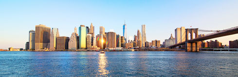 Panorama New York City skyline. Panorama view of New York City Manhattan downtown skyline and Brooklyn bridge in the morning royalty free stock photography