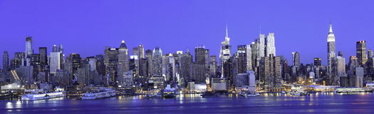 Manhattan Panorama Blue Sky. Panorama of New York Manhattan at Night from JFK Boulevard East in New Jersey. New York is the most populous city in the United Stock Images