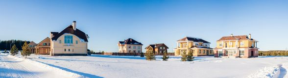 Panorama of Newly Built Suburban Houses in winter time stock photo
