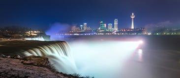 Panorama of Niagara Falls at night from New York. Niagara Fall lit up at night from New York Stock Photos