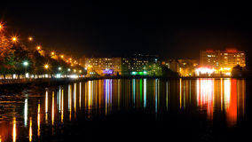 Panorama night city lights. Colourfull reflection in water Royalty Free Stock Image