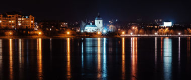 Panorama of night city lights and reflections on lake at Ternopi Stock Photos