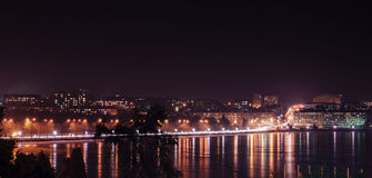 Panorama of night city lights and reflections on lake at Ternopi Stock Photography