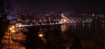Panorama of night city lights and reflections on lake at Ternopi Royalty Free Stock Photos