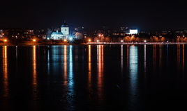 Panorama of night city lights and reflections on lake at Ternopi Royalty Free Stock Photography