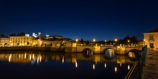 Panorama of the night city of Tavira. Roman bridge. Royalty Free Stock Photography