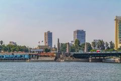 Panorama of the Nile River, view of the Cairo city bridges buildings and pyramids. Nile River, view of the Cairo city bridges buildings and pyramids royalty free stock photography