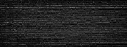 Panorama noir de mur de briques images stock