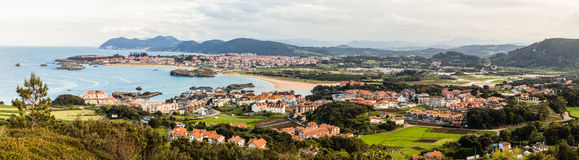 Panorama of Noja in Cantabria, Spain. Panoramic view of the touristic villages of Noja and Isla, Cantabria, northern coast of Spain. Sunny blue sea and beaches Royalty Free Stock Photo