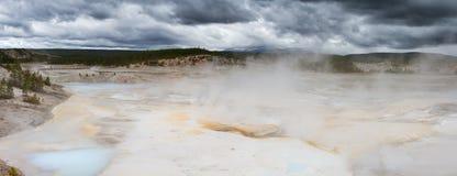 Panorama of Norris Geyer Basin under dark clouds Royalty Free Stock Photo