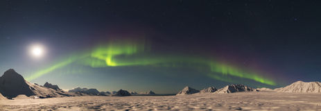 PANORAMA - Northern Lights above the Arctic glacier - Svalbard, Spitsbergen. Natural phenomenon of Northern Lights (Aurora Borealis) related to the earth's stock photography