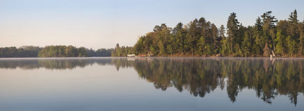 Panorama of Northern Minnesota Lakeshore on a Calm Morning Durin Stock Photos