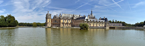 Panorama of the Northern part of Chantilly castle. With the stave at foreground Royalty Free Stock Photo