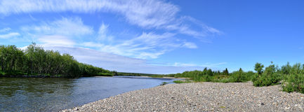 Panorama of Northern Ural river under the sun. Royalty Free Stock Photo