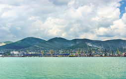 Panorama of Novorossiysk sea port on the background ridge mountains Royalty Free Stock Photography