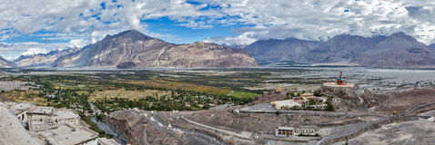 Panorama of Nubra valley in Himalayas. With giant Buddha statue in Diskit, Ladakh, India Royalty Free Stock Photo