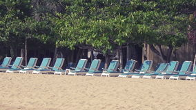 Panorama on a number of empty chaise lounges standing on sandy beach of the tropical resort. Panorama on a number of the empty chaise lounges standing on the stock video footage