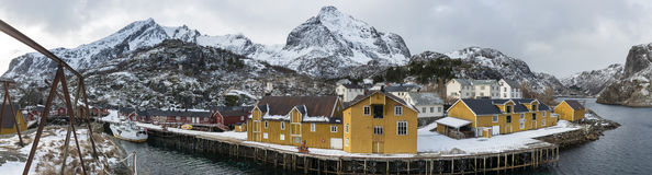 Panorama of Nusfjord fishing harbor in the winter time on the Lo Stock Photo