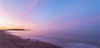 Panorama of  ocean beach at the crack of dawn Stock Images