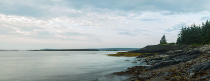 Panorama of ocean shore in the morning (Slow shutter speed) Stock Photo