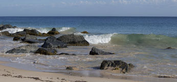 Panorama of the Ocean Splashing on the Rocks Stock Photography