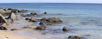 Panorama of the Ocean Splashing on the Rocks Royalty Free Stock Photo