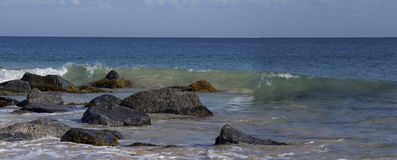 Panorama of the Ocean Splashing on the Rocks Stock Image
