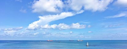 Panorama ocean view. Panorama commercial vessels in the mid of nowhere Stock Photos