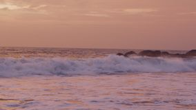 Panorama of ocean waves at sunset. Slow motion stock video footage