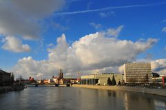 Panorama of Odra River and University library seen from grunwaldzki bridge. Wroclaw, Poland 2018. With clouds and ostrow tumski towers in the back royalty free stock images